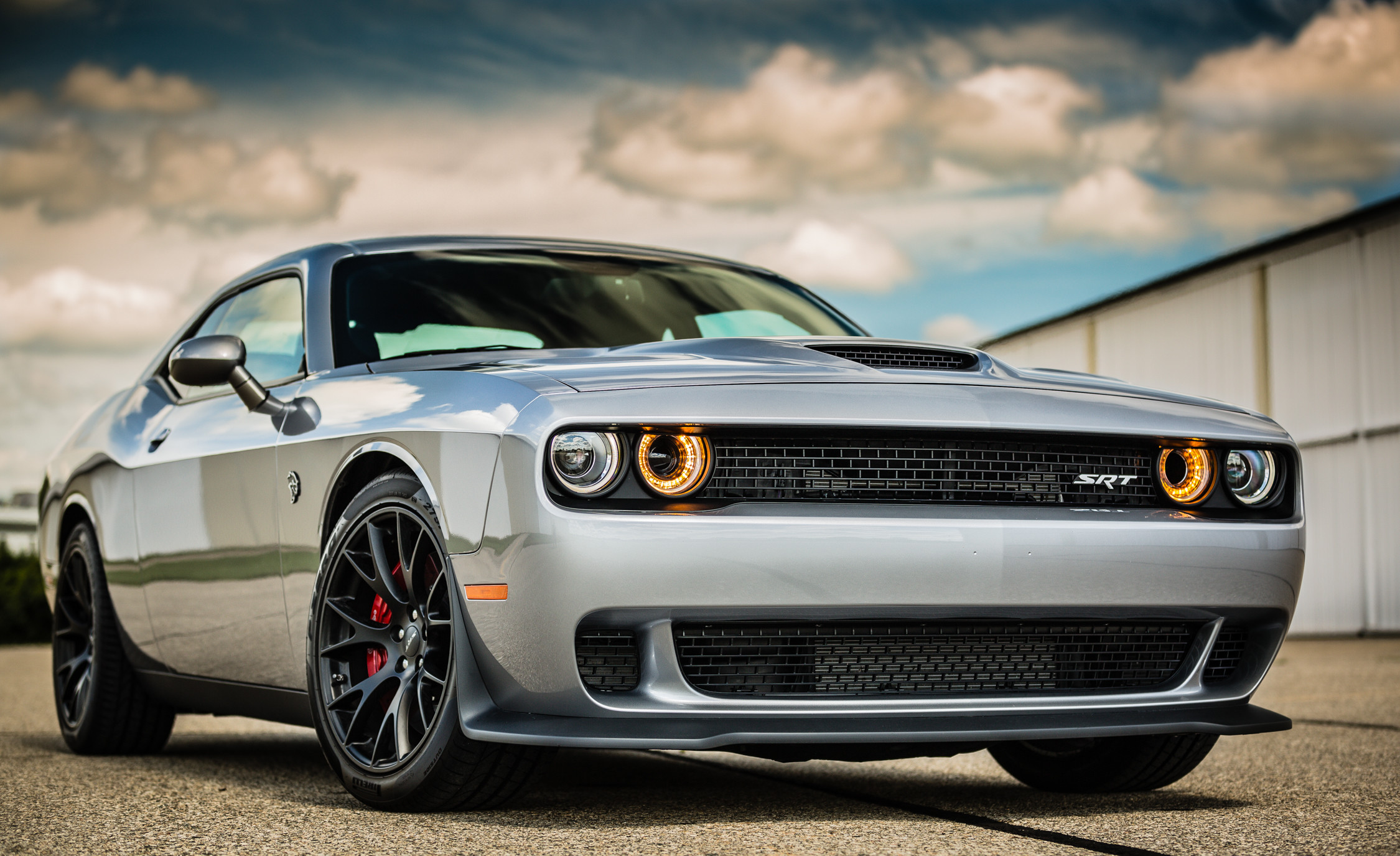 dodge challenger Ever since the challenger's 2009 reincarnation as a retro-modern muscle car, dodge has made a series of civilizing upgrades to the interior, improved the handling, and given it the latest version.