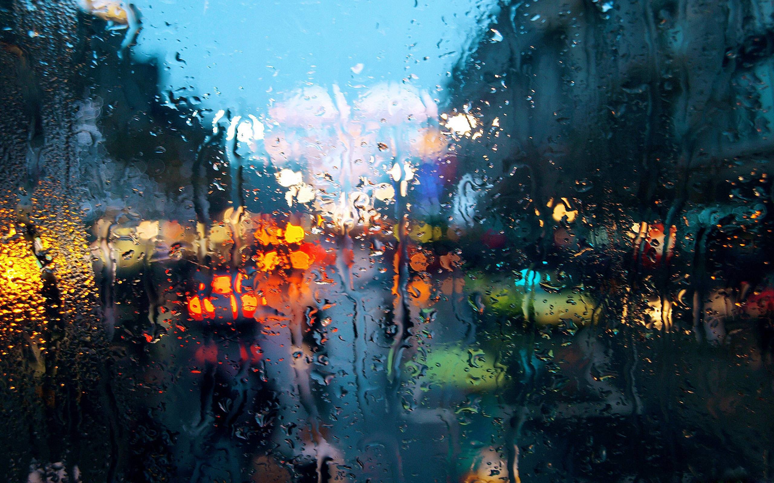 rain on window wallpaper ·①
