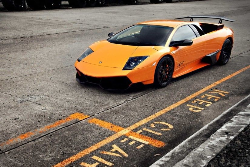 Download the following Orange Car Wallpaper 32761 by clicking the orange  button positioned underneath the ""