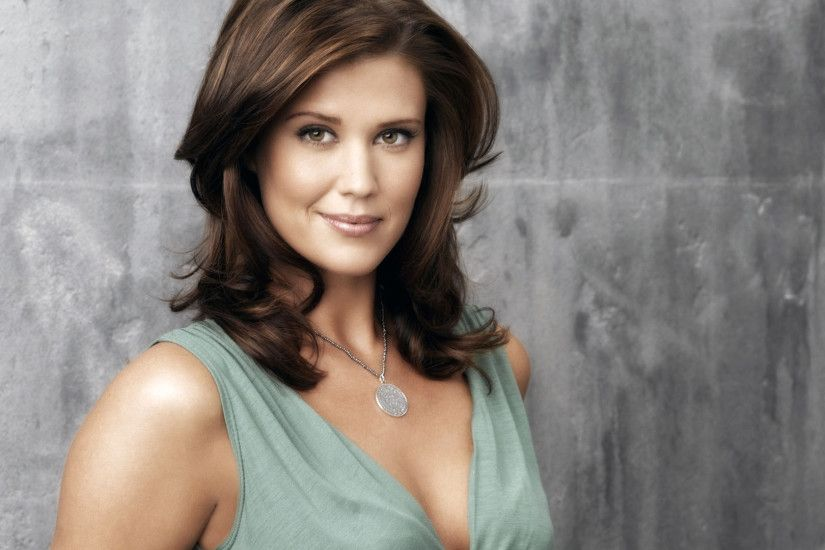 Sarah Lancaster smiling in a blue top wallpaper - Celebrity wallpapers .