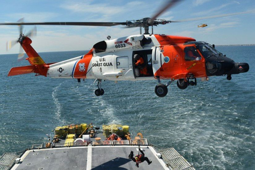 Coast Guard 6033 practicing shipboard hoisting as a Canadian Merlin  Helicopter observes.
