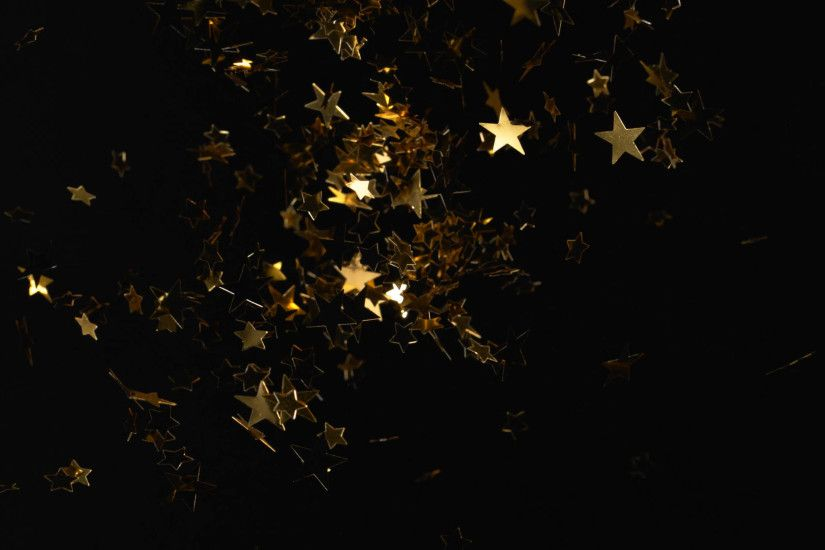 Star shpe gold confetti fly after being exploded against black background.  4K 30fps. Slow Motion. Stock Video Footage - VideoBlocks