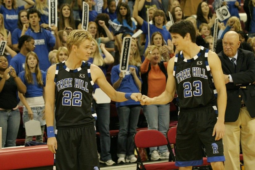 Lucas Scott and Nathan Scott in their black Tree Hill basketball (away  game) uniforms.
