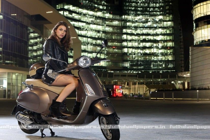women model on scooter