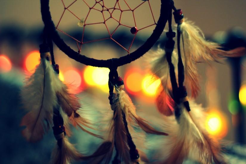 Macro of dreamcatcher on bokeh background amulets and talismans.