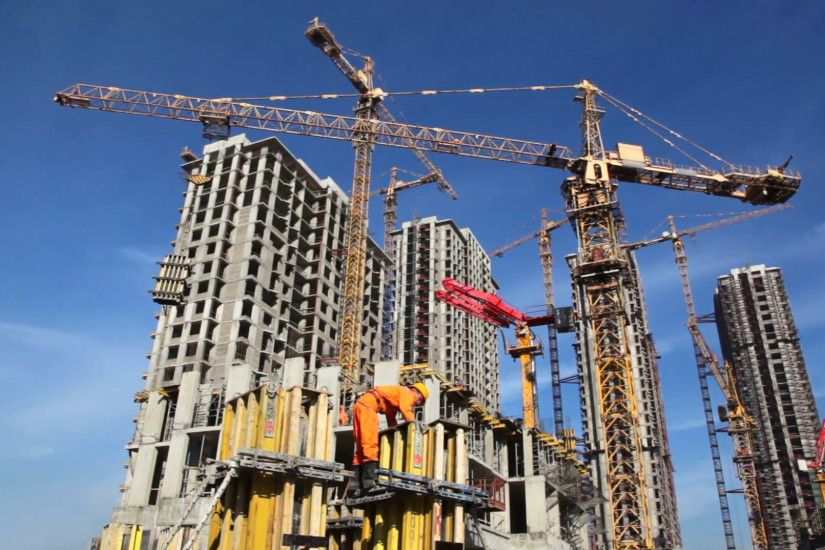 Builder works at against background of the construction site high-rise  buildings Stock Video Footage - VideoBlocks