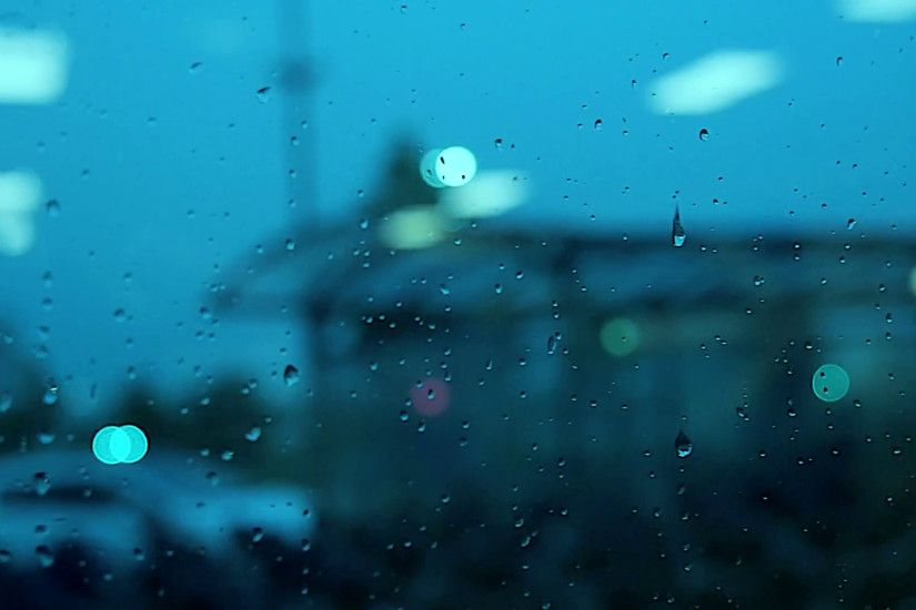 water drops on window. rain raining. crying sadness sad. blurred background