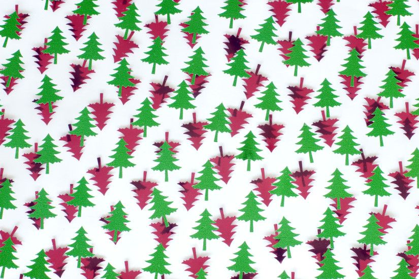 a festive themed background of red and green christmas pine tree shapes