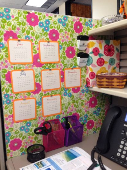 Wrapping paper as wallpaper in a boring gray cubicle. Magnets hold calendar  made with my