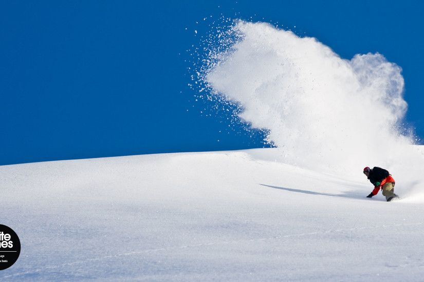 Snowboard Wallpaper – Scotty Lago kicks up a rooster tail in Alaska