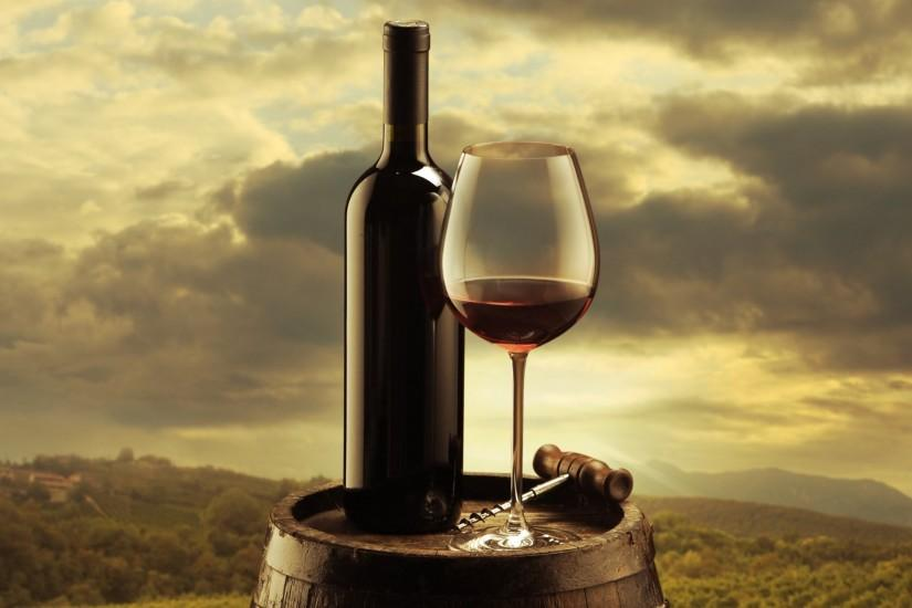 wine red a bottle glass corkscrew barrels background sky clouds vineyards