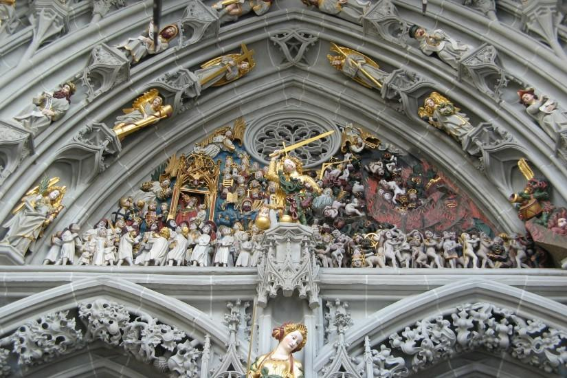 Cathedral of Berne Munster Switzerland statue sculpture weapons angels  religion catholic wallpaper