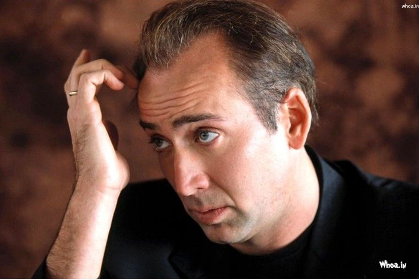 ... Background Wallpaper; Nicolas Cage Black Suit with Brown Background ...