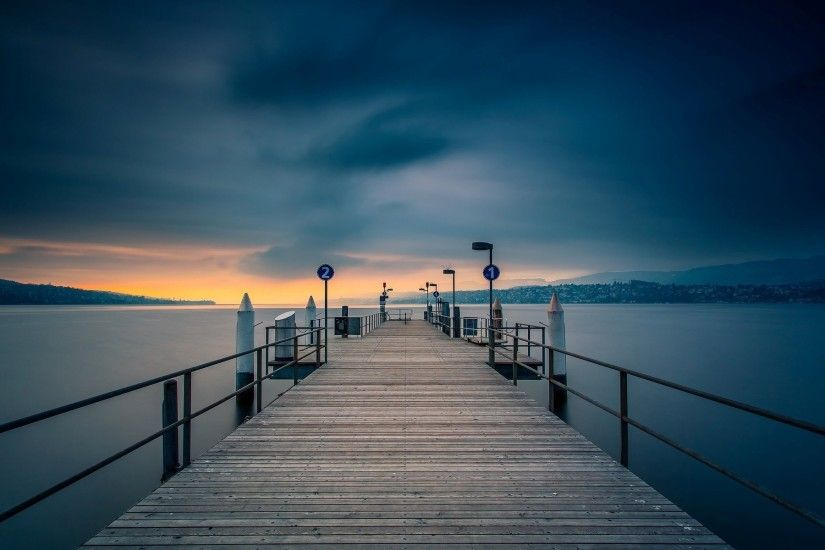 wooden pier in the evening with wide landscape picture