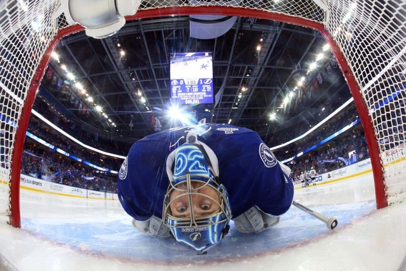 Tampa Bay Lightning goalie Ben Bishop leans back to stretch before game one  of the 2015 Stanley Cup Final against the Chicago Blackhawks at Amalie  Arena, ...