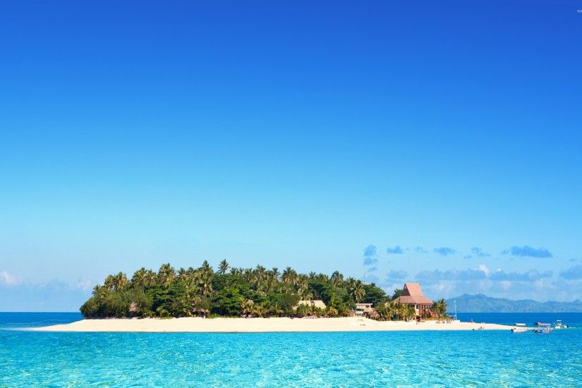 Clear sky over a resort on a Fiji island wallpaper