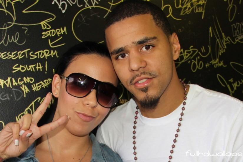 J Cole with his girlfriend