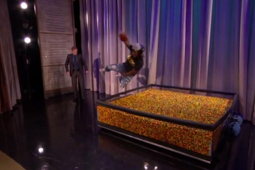 Marshawn Lynch dives into an end zone of Skittles on 'Conan' | NFL |  Sporting News