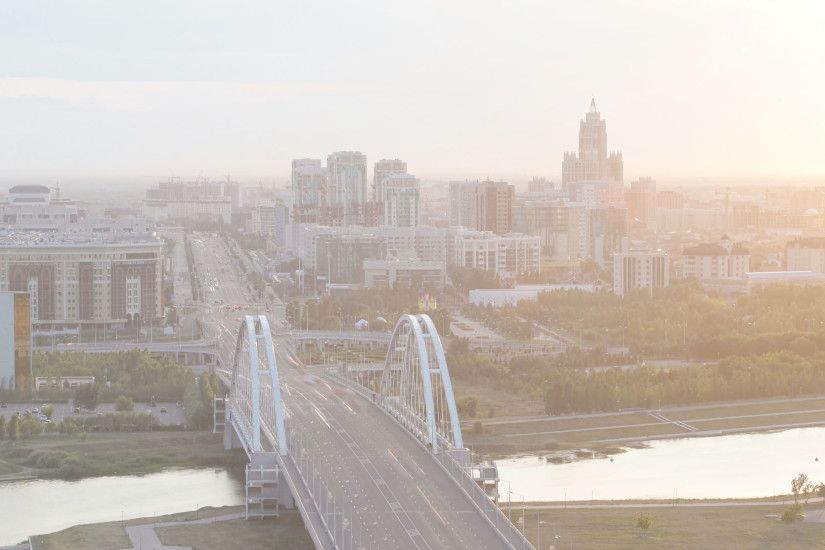 Sunset timelapse above the Bridge over the river with the transport traffic  and clouds on the background. City skyline. Central Asia, Kazakhstan,  Astana 4K ...