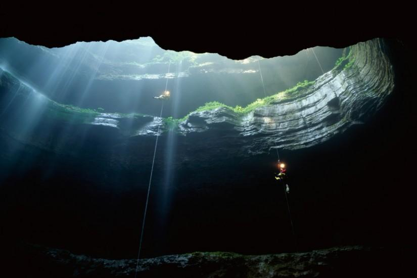 Spelunkers rappel into Neversink Pit, Jackson County, Alabama