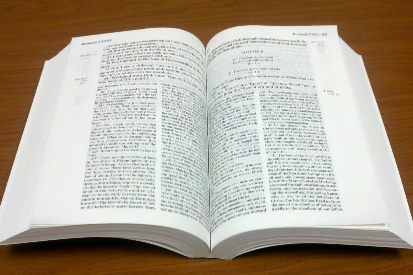 Open holy bible with cross russian open holy bible with