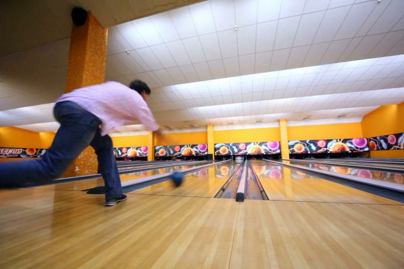 Man throws bowling ball and makes strike by beats all skittles Stock Video  Footage - VideoBlocks