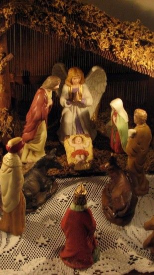 Preview wallpaper christmas, holiday, candles, jesus, angel, figurines,  people 1440x2560