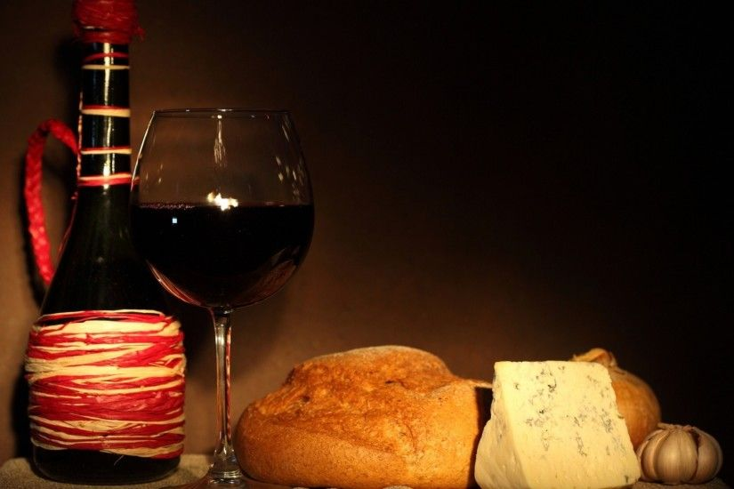 torment bread red wine glass garlic a bottle cheese