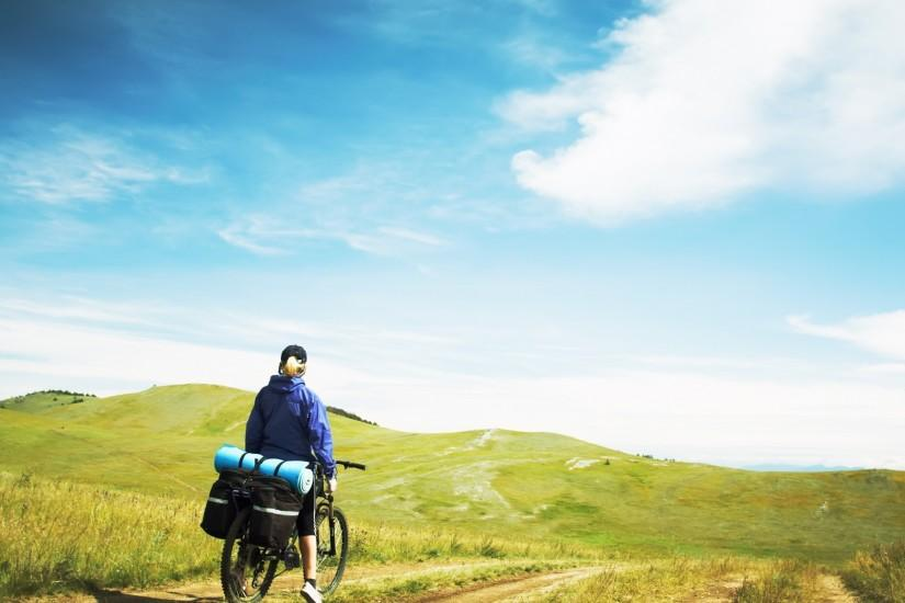 2048x1152 Wallpaper mountains, slopes, travel, bicycle, back, girl