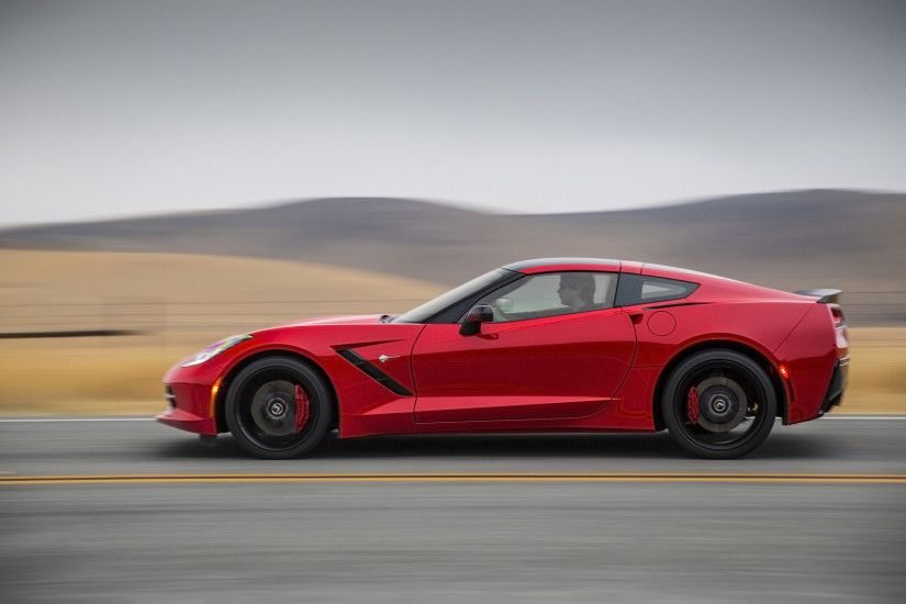 2014 Red Chevrolet Corvette Stingray Side Motion wallpapers and stock photos