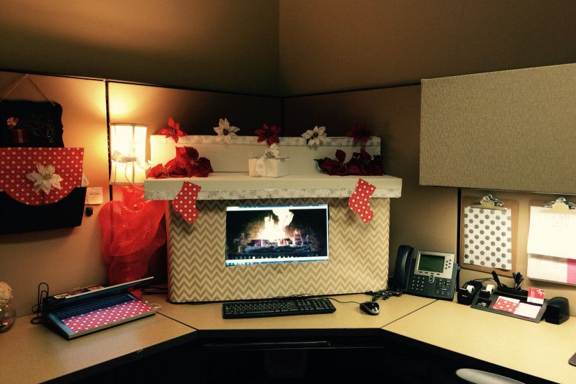 My Christmas ready office cubicle decor! I used boxes and gift wrap cut  around the monitor and a fireplace background.
