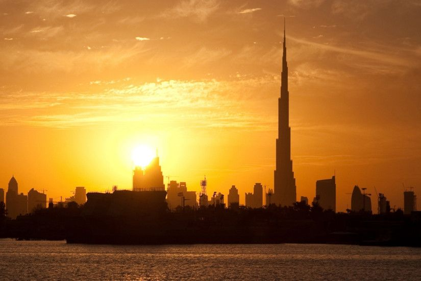 Preview wallpaper dubai, buildings, houses, silhouette, sunset, distance,  sky,