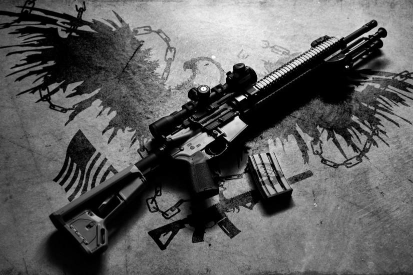 AR-15 rifle on the ground wallpaper