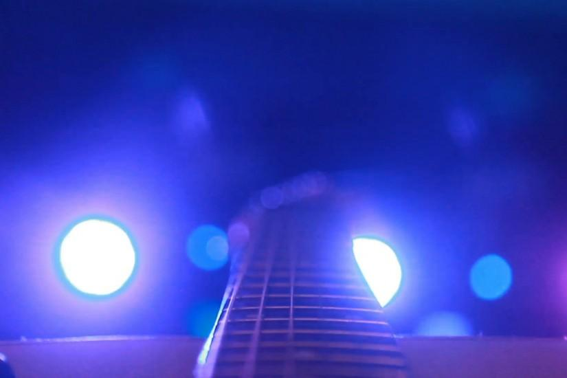 rock concert: backstage: guitar on the background of stage lighting Stock  Video Footage - VideoBlocks