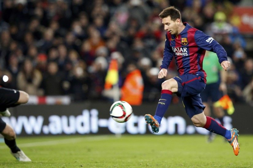 Barcelona's Lionel Messi kicks to score a goal during their King's Cup  quarter-final first