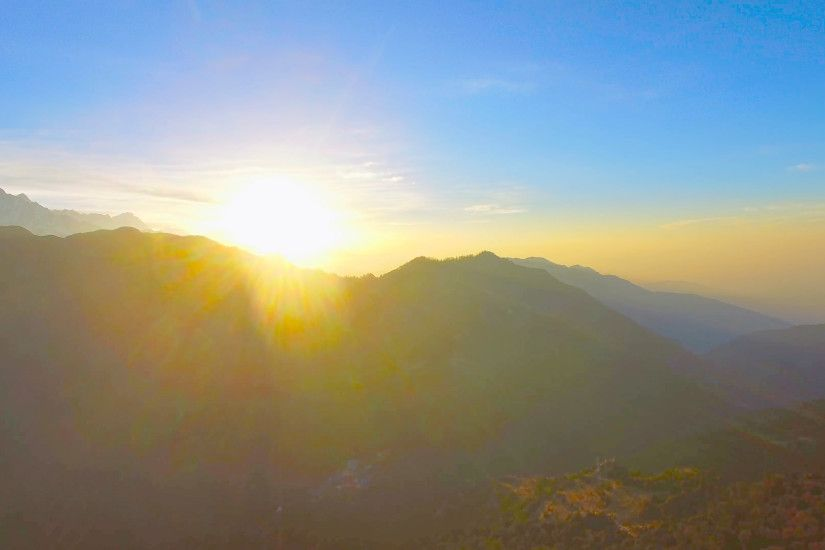 Sunrise over mountains Nature background aerial video 4k. Sunset Sunshine  in Himalayas Nepal. Sun rises on clear sky. Stock Video Footage -  VideoBlocks