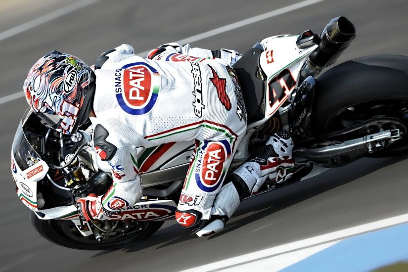 sports photography of motorcycle racer in white and red gear