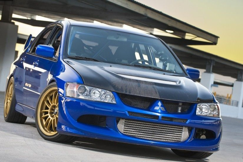 Blue sporty Mitsubishi Lancer Evolution IX