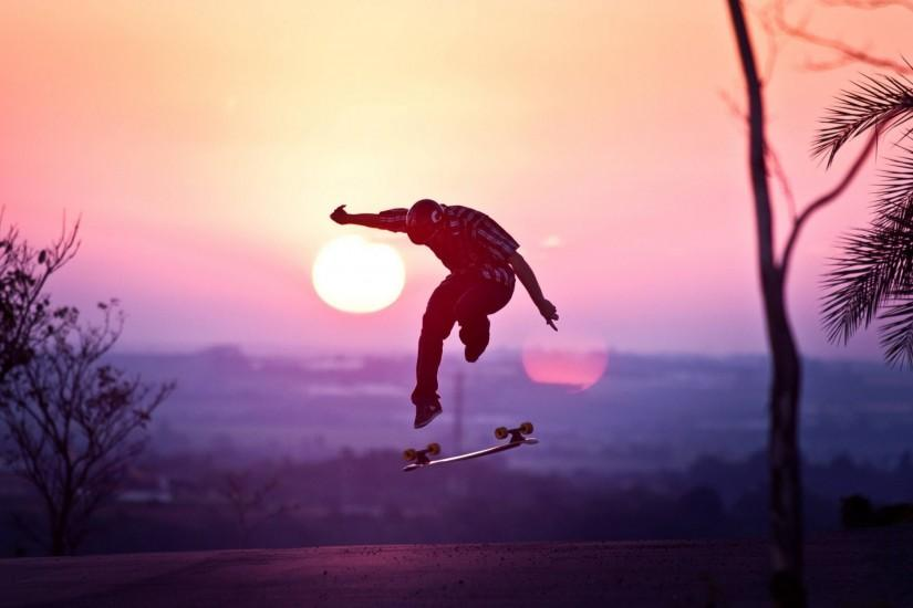 guy helmet skateboard jump sun sunset