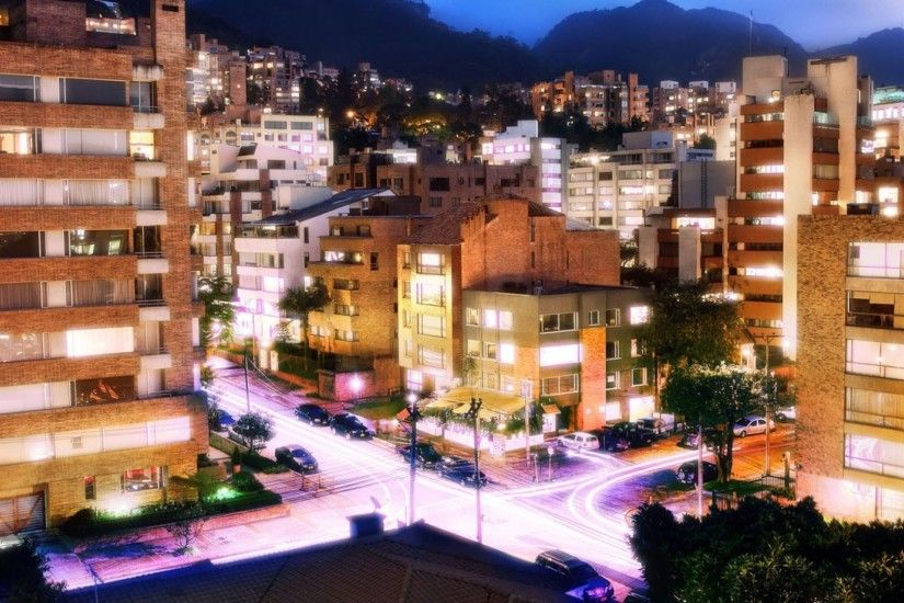 2560x1080 Wallpaper bogota, colombia, night, building, road, traffic