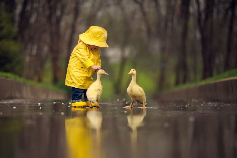 Little Baby With Ducks Wallpaper