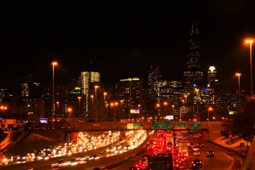 Chicago Rush Hour Traffic -Close Up Downtown -Chicago Skyline Background  Nighttime -Time Lapse 4K