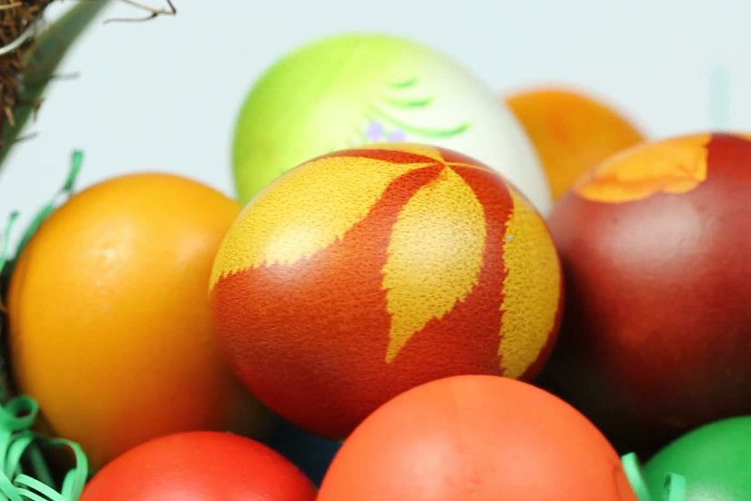 Closeup of a nicely decorated Easter Egg Basket (full of hand - colored eggs )