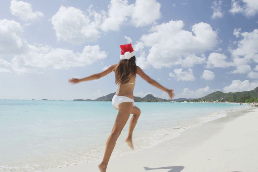 Christmas beach girl in santa hat jumping running on holidays vacation  Stock Video Footage - VideoBlocks