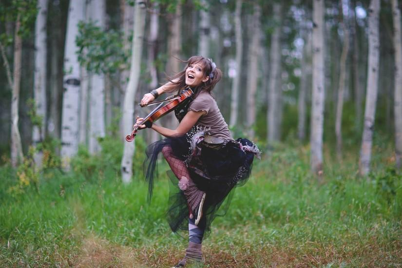 Lindsey Stirling Jumping in the Woods for 2560x1440
