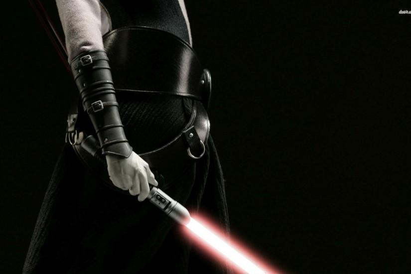 Sith With A Lightsaber Wallpaper