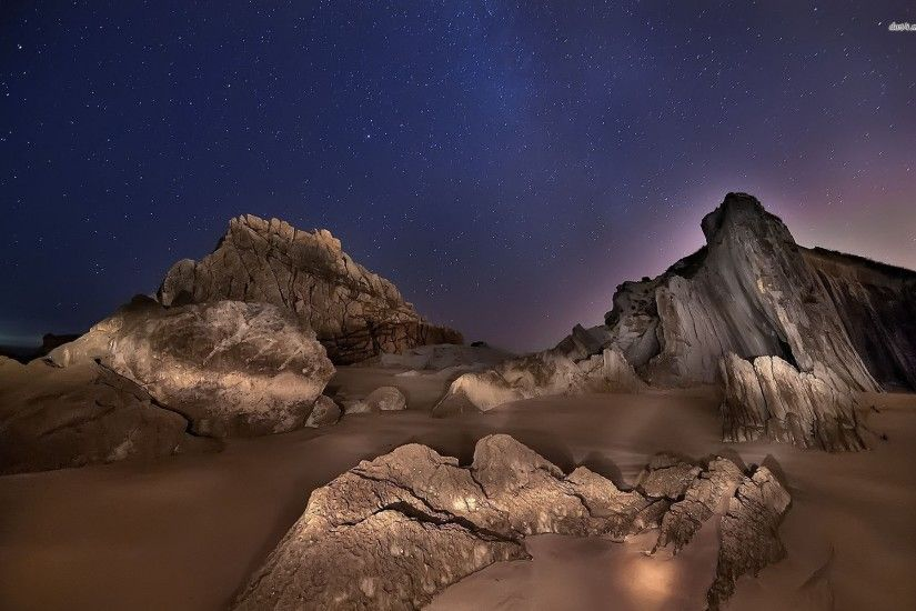 Rock Formations Under The Starry Sky Wallpaper
