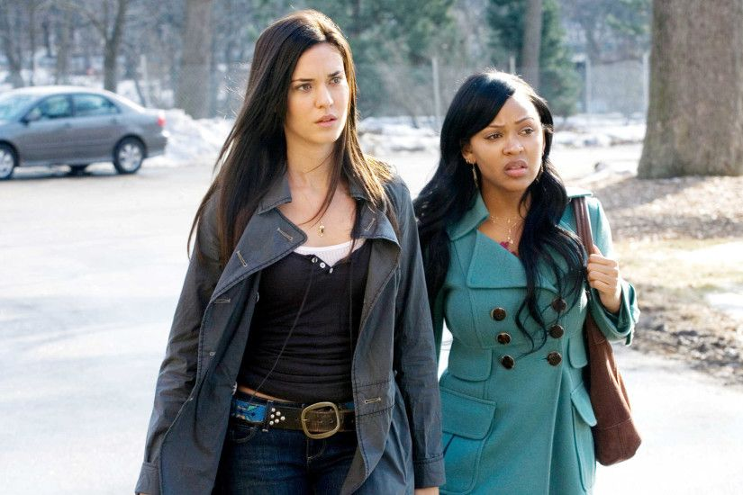 Odette Yustman stars as Casey Beldon and Meagan Good stars as Romy in Rogue  Pictures' The Unborn (2009)