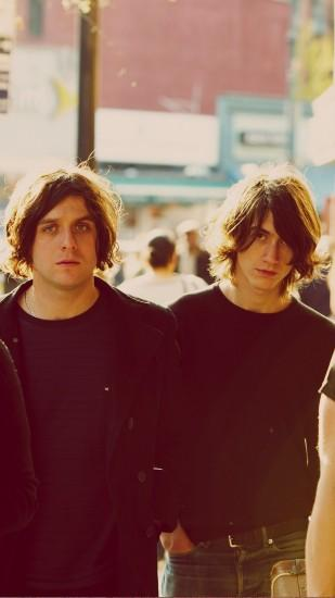 Download Free Arctic Monkeys Wallpaper for Mobile.