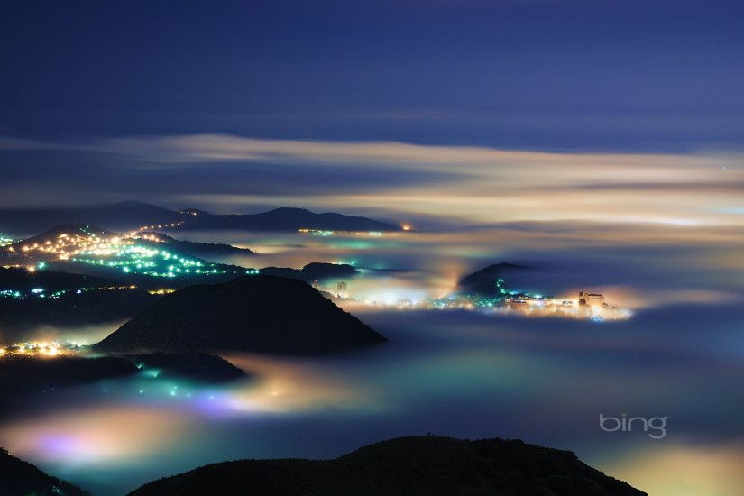 mount datun night image with fog over villages